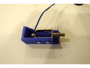 Bracket to mount solenoid for Virtual pinball machine force feedback.