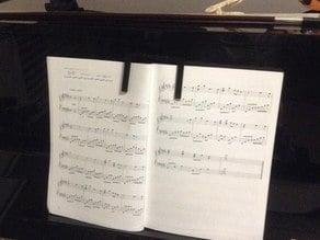 Piano book opener