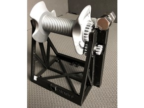 Multiple Mechanism Auto-Rewind Spool Holder