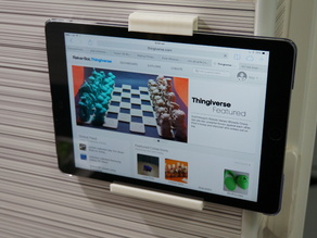 Ipad/tablet wall mounted shelf and top clip