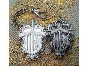 Lunafreya's family crest brooche and keychain