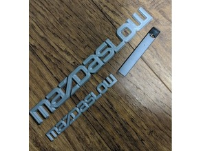 Mazdaslow Badge And License plate frame (2 piece fits 120x120mm)