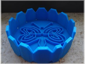 Tray design with a labyrinthine heart butterfly within
