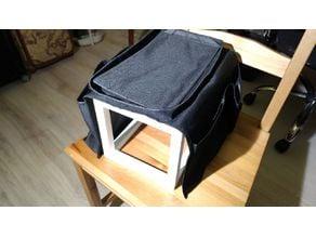 Frame for vehicle backseat armrest