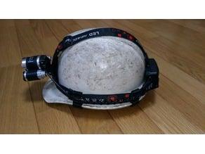 Headlight holder for helmet