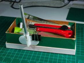 Xacto holder for desk use