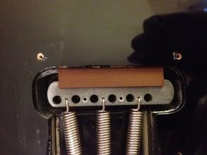 Bridge spacer for Fender Stratocaster tremolo bridge