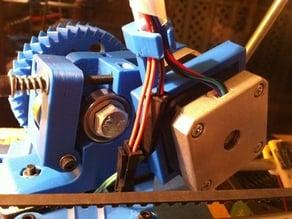 Extruder motor strain relief bracket