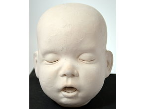 Life size baby doll head