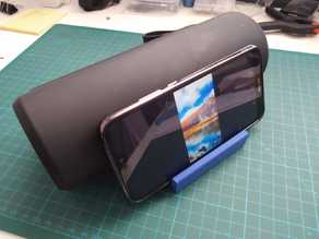 Bluetooth speaker and phone table stand