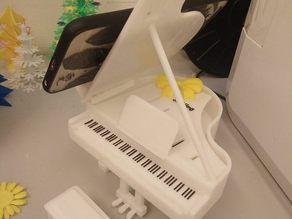 Piano with phone holder
