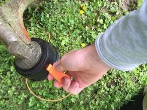 Device to remove Stihl line spools