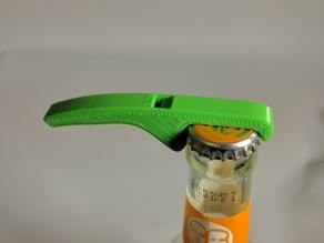 Bottle opener with whistle