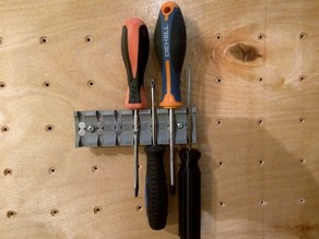 Peg board screwdrivers holder