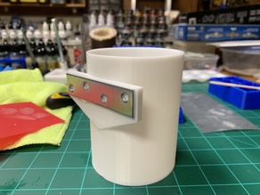 Tool cups for magnetic strip