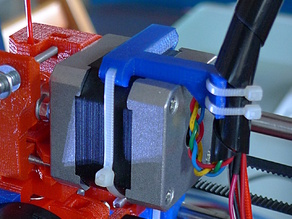 Stepper mounted extruder cable harness strain relief