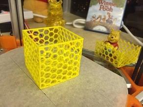 Box with honeycomb hole pattern