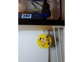 Filament holder hanging on filament entry through Ikea desk