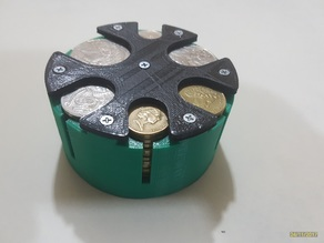 Coin holder with spring lifts for Australian coins