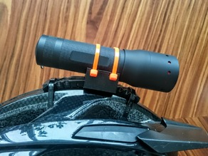 Universal flashlight helmet mount
