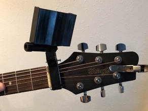 Guitar neck phone holder