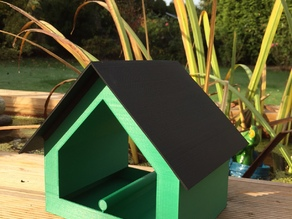 Birds feed house, with double sided wall storage