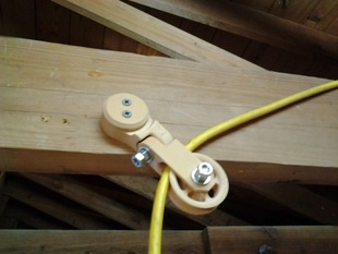Overhead extension cord pulley