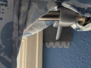 Damage free curtain rod hanger