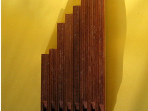 an octave of tiny organ pipes