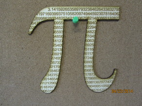 Laser cut pi symbol cut from 788 digits of the never ending number.