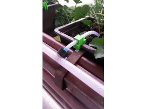 Plastic flower box irrigation tube holder