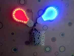 Case for incandescent light bulb symbol with leds