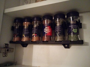 Spice shelf with holders