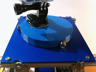 Rotating platform with actuator (e.g. for timelapse photography)