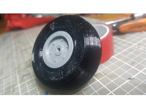 2 inch RC airplane wheel with a 3 mm center hole.