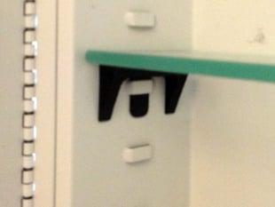 Shelf holder for old medicine cabinet