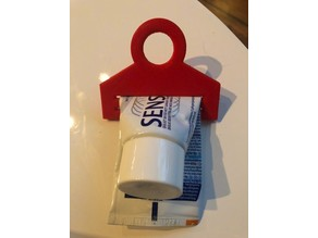 Toothpaste squeezer / holder