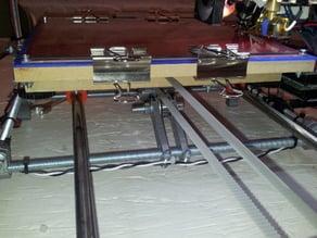 Parametric Y-axis belt tensioner / vibration management