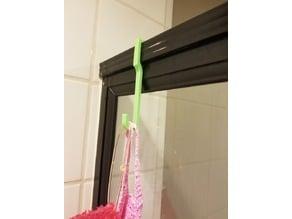 Old glass shower hook