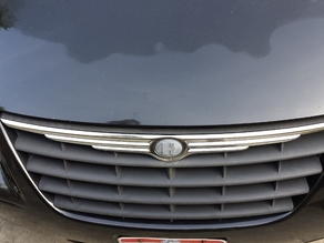 Nameplate for a Chrysler Minivan