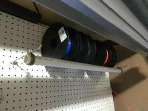 Pegboard mounted multi-spool holder