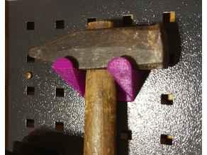 Hammer holder for OBI pegboards