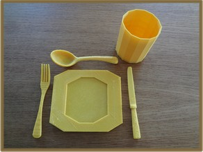 cutlery, plate and cup