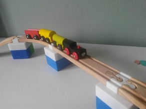 Wooden brio train track to Mega Bloks