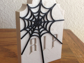 Tombstone with Web