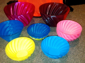 Helical fluted bowls