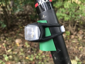 Angled filler for bicycle seatpost lights