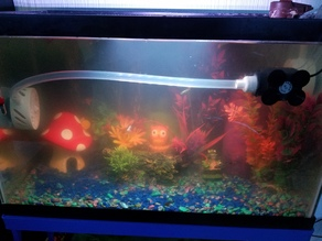Fish tank powered water scrubber and current generator