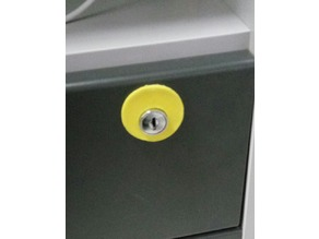 Off-center cover for drawer lock
