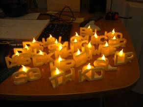 Printed 'place cards' with tealight holder